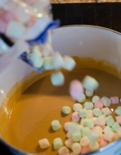 Creamy fluffy and buttery scotchy! these Butterscotch confetti squares (Peanut butter marshmallow squares) are incredibly easy to make and are a perfect fit for any party. Here we are adding the fruity mini marshmallows to the pot.