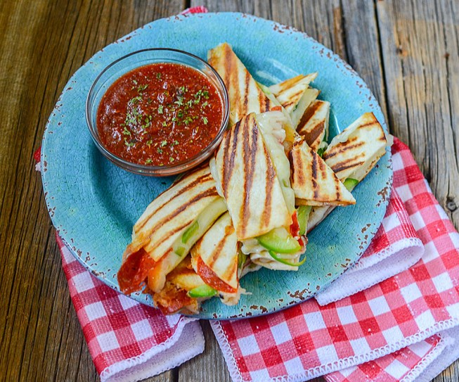 Super ooey gooey cheesy pizza quesadilla sticks! Awesome snack or lunch food! Healthy tortilla pizzas made with a variety of toppings are great for frugal meals as well!