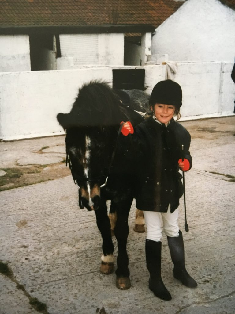 Louise riding as a youngster