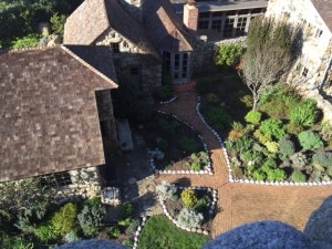An aerial view from Hawk Tower, built by Jeffers, looks down upon Tor House and its accompanying garden.