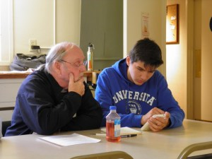 President Alessandro Boara works one-on-one with a senior citizen to help him grow more comfortable using an iPhone.