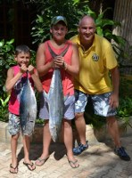 George, Douglas and Brad dripping fish blood in the Barra Lodge Reception area. Sorry John!