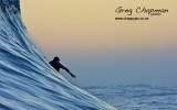 Surfing big waves: The Roosta being whipped in from the back back...at Dungeons (c) Craig Chapman