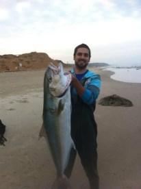 Aviv Hayan hoists his 23kg Amberjack taken off the side in Israel