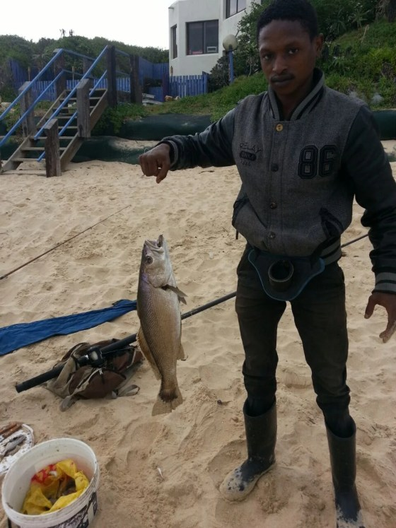 Jos Jantjies with a tasty kob caught down at Kabeljauw's, down the point, in Jeffreys Bay (c) artsurfer.nl