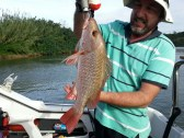 Chris fishing with Rory and Gavin on Happy Daze in the Umzimkulu yesterday.
