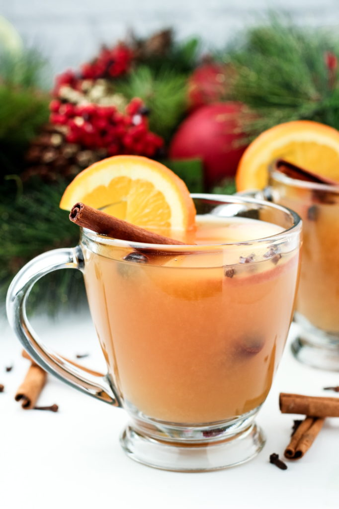 Nothing says the holidays like this warm, spiced apple cider punch! It's sweet, tangy and perfectly spiced, plus it makes the entire house smell just wonderful! #wassail #easyrecipes #delicious #christmasdrinks #holidaydrinks