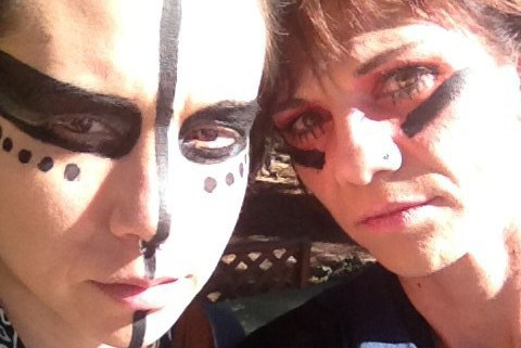 Two female roller derby girls looking tough