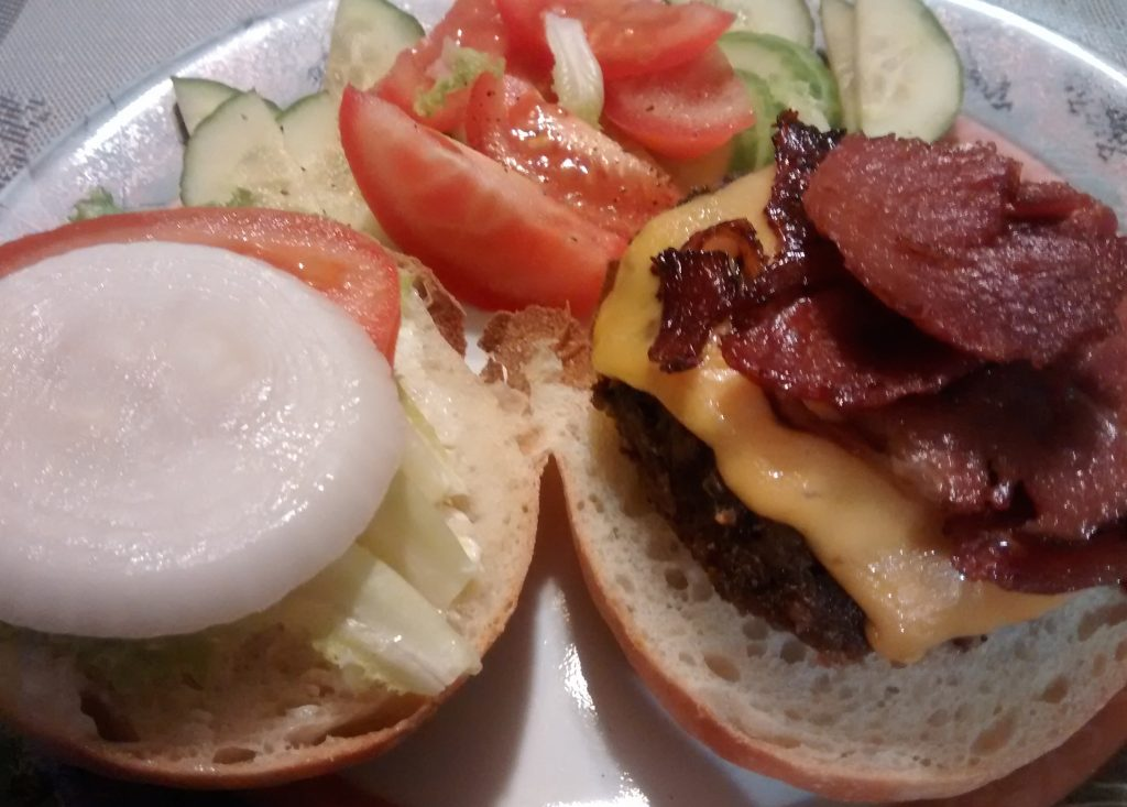 Burger with bacon and veggie salad