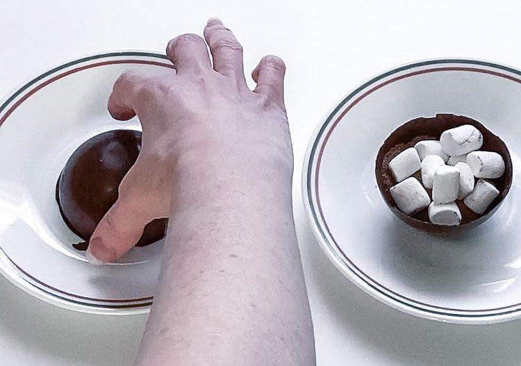 chocolate bomb half melting on a warm plate