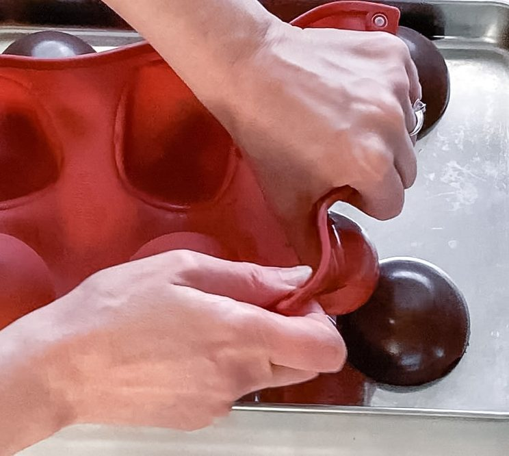 Removing chocolate halves from silicone mold