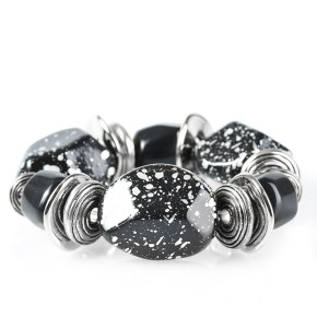 Chunky black beads with speckles of silver and a gorgeous glazed finish are threaded along a stretchy band with thick silver rings.