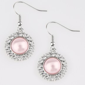 pink earring with rhinestones surrounding the center
