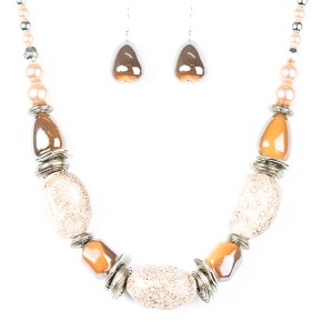 Chunky amber and peach beads with a beautiful glazed finish are complemented by large speckled faux rocks and pearly brown beads. Features an adjustable clasp closure.