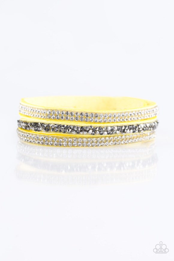 Glittery white and glassy hematite rhinestones are sprinkled along three strands of bright yellow suede for a glamorous look. Features an adjustable snap closure. Sold as one individual bracelet.
