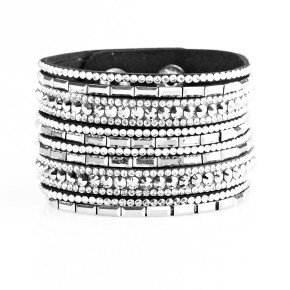 Varying in size and shape, glassy white rhinestones are encrusted along strands of black suede for a sassy look. Features an adjustable snap closure. Sold as one individual bracelet.