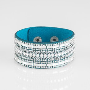Featuring classic round and edgy emerald style cuts, glittery white rhinestones and glistening silver chains are encrusted along bands of blue suede for a sassy look. Features an adjustable snap closure. Sold as one individual bracelet.