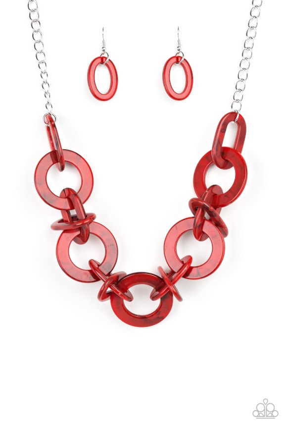 Brushed in a faux-marble finish, bold red links connect below the collar for a statement making look. Features an adjustable clasp closure. Sold as one individual necklace. Includes one pair of matching earrings.