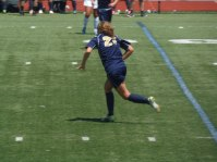 Junior Maddie Toth chasing the play down the field as the ball gets away from her.