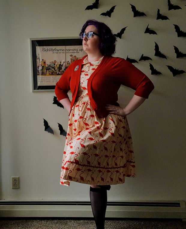 A woman wearing the Sammy dress in flamingo print from Lindy Bop