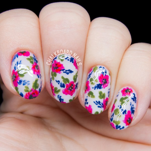 Close up of pink and blue floral nail art
