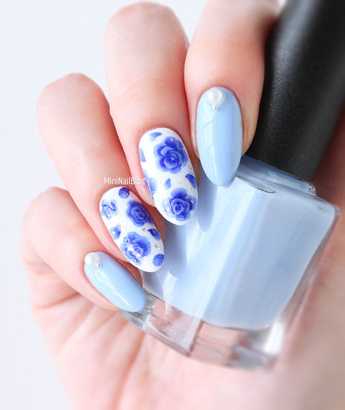 Close up of blue floral nail art