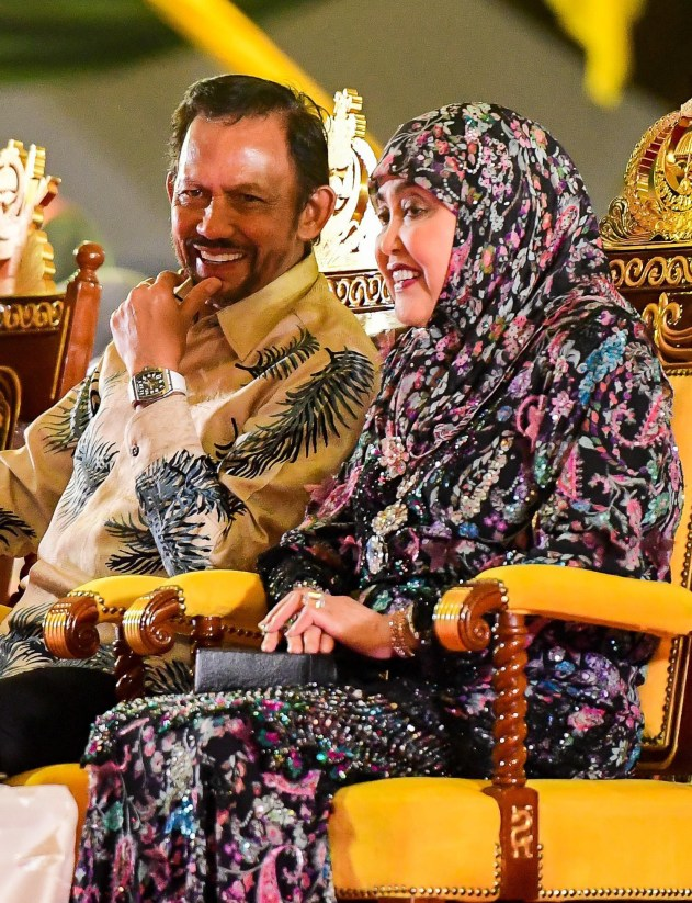 Their Majesties share a light moment during the festivities yesterday. Photo: Infofoto