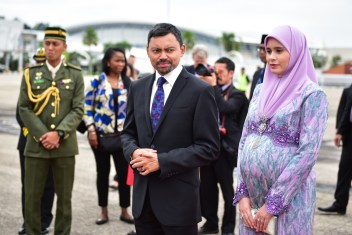 HRH Prince Haji Al-Muhtadee Billah and HRH Princess Sarah await the arrival Prince Charles and Camilla at Brunei International Airport. Photo: Infofoto