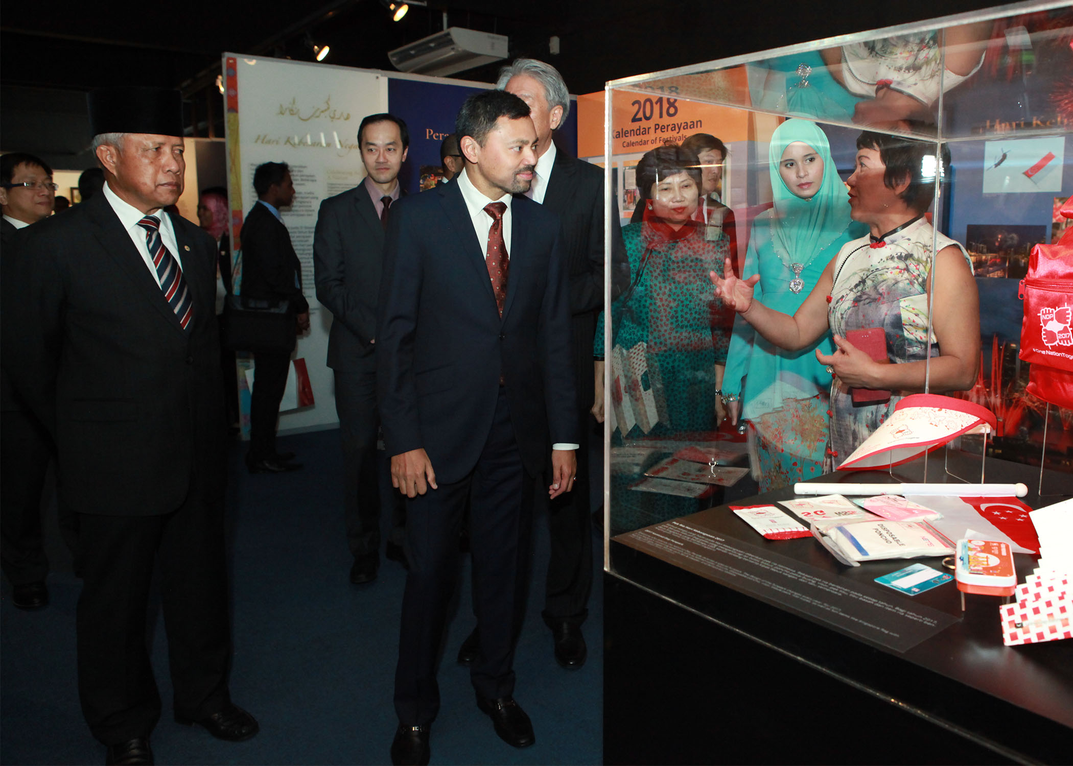 HRH Prince Haji Al-Muhtadee Billah, the Crown Prince and Senior Minister at the Prime Minister's Office and Singapore's Deputy Prime Minister Teo Chee Hean view the exhibits at the 'Abode of Peace & the Lion City: A Brunei-Singapore Exhibition' at Royal Wharf in the capital. Photo: Rasidah Hj Abu Bakar