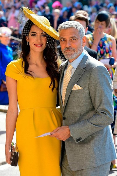 Human rights lawyer Amal Clooney and actor George Clooney arrives at St George's Chapel. Photo via Twitter