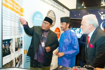 His Majesty is briefed by TelBru employees during an exhibition set up in conjunction with a Hari Raya celebration organised by Yayasan Sultan Haji Hassanal Bolkiah on July 5, 2018. Photo: Infofoto