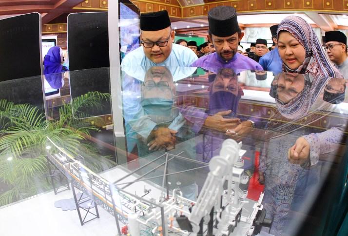 HM the Sultan tours an exhibition set up in conjunction with a Hari Raya celebration organised by Yayasan Sultan Haji Hassanal Bolkiah on July 5, 2018. Photo: Saifulizam Zamhor