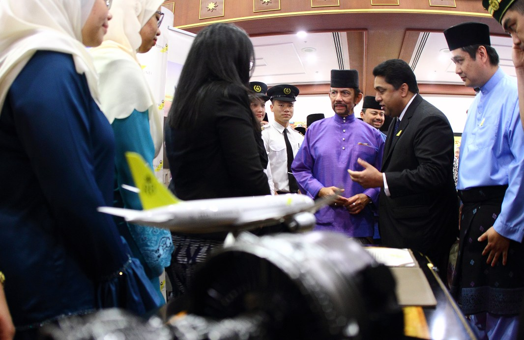 HM the Sultan is briefed by Royal Brunei Airlines CEO, Karam Chand (2R) at an exhibition set up in conjunction with a Hari Raya celebration organised by Yayasan Sultan Haji Hassanal Bolkiah on July 5, 2018. Photo: Saifulizam Zamhor