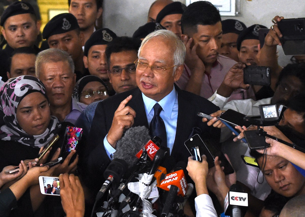Najib hit with 25 new charges over 1MDB scandal