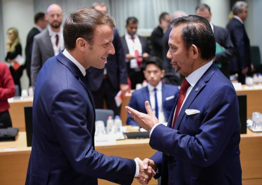 France's President Emmanuel Macron (L) shakes hands with Sultan of Brunei Haji Hassanal Bolkiah ahead of a Asia Europe Meeting (ASEM) at the European Council in Brussels on October 19, 2018. Photo: John Thys/AFP