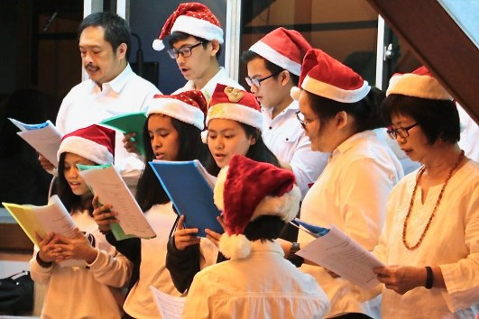Carolers perform at the Church of Our Lady of Assumption Catholic Church on Christmas Eve 2018. Photo: Wardi Wasil/The Scoop