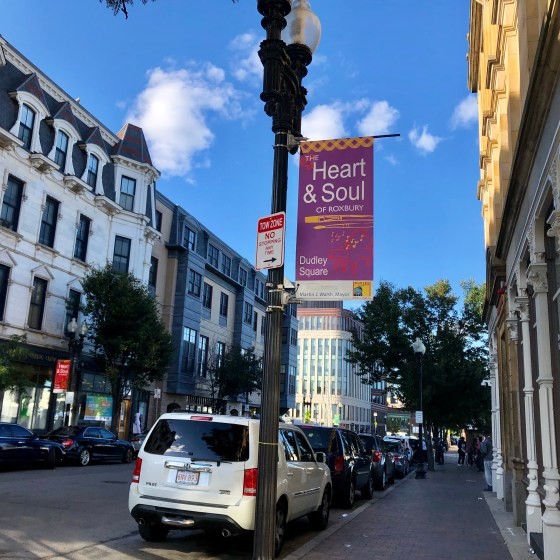 "Banners across the streets of Dudley Square pronounce, ""Dudley Square: the Heart and Soul of Roxbury."" Photo by Eileen O'Grady."