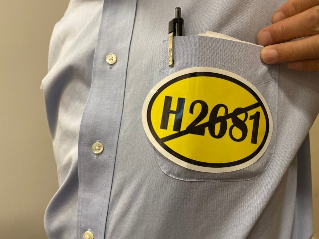 "Opponents of the bill wore yellow stickers that read ""H.2681"" with a line through it. Photo by Alexa Gagosz."