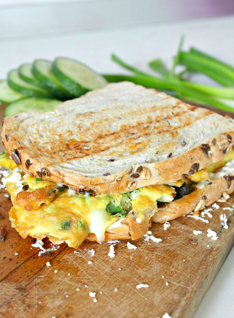 This omelette sandwich, packed with awesome, tasty ingredients, will help you start your day in a bright mood.