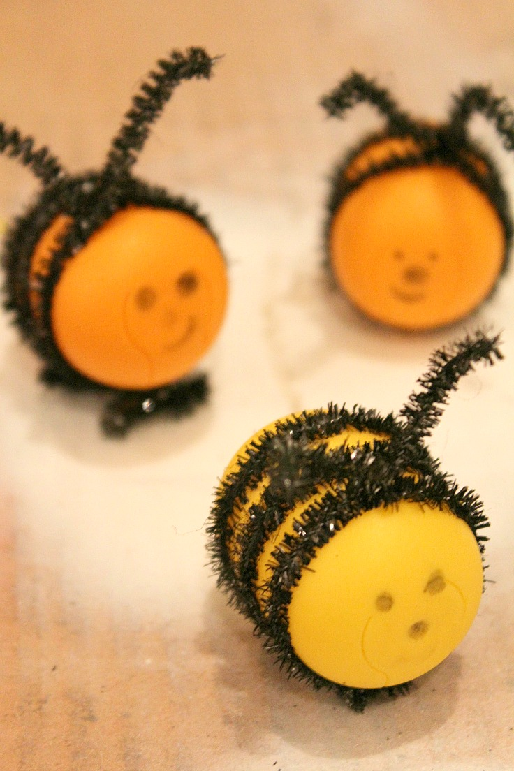 Bee craft for kids from recycled Kinder egg shells and black chenille pipes