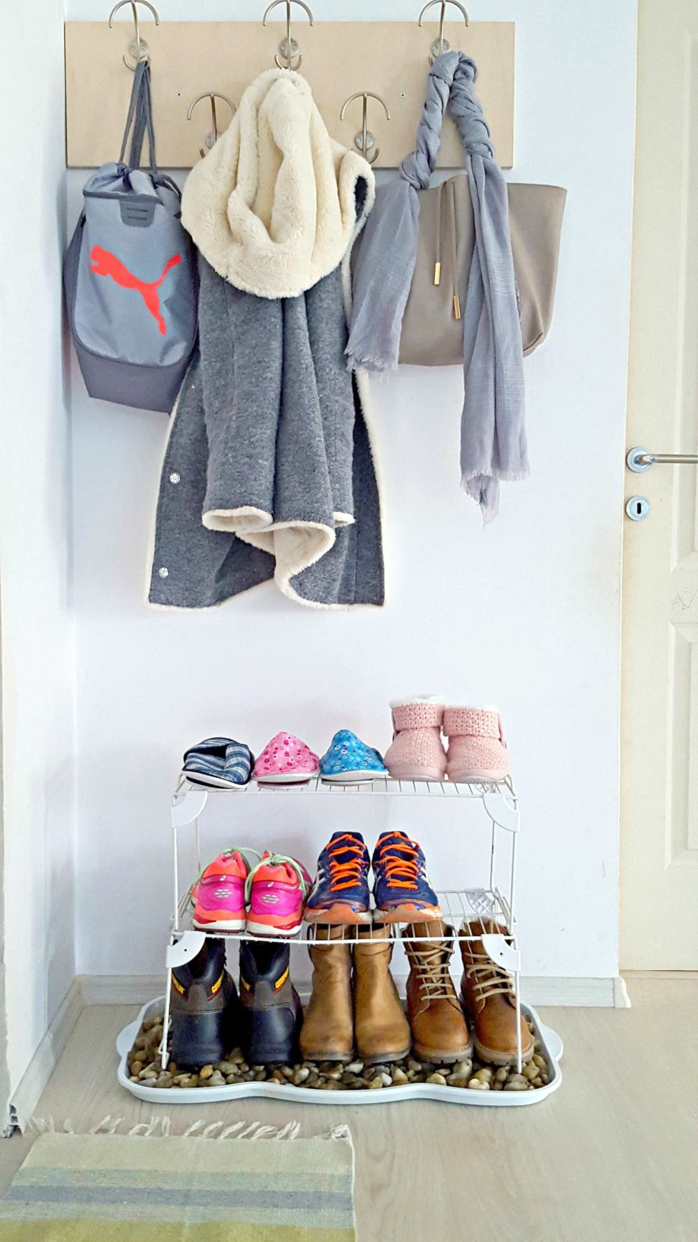 Upgrade an old boot tray with this DIY shoe storage! Perfect for snowy boots, this front door shoe storage idea will completely change the look of your entryway!
