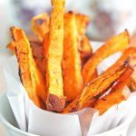 Make healthy french fries without sacrificing taste with these easy garlic sweet potato fries! A great appetizer or snack for holidays!