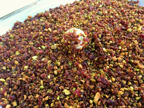 Rolling the goat cheese balls in the craisin pistachio mixture