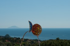 A sculpture in a small piazza overlooking the sea.