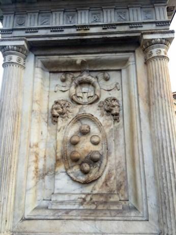 In Piazza San Lorenzo, the Medici coat of arms on the plinth of a statue of Ludovico di Giovanni de' Medici, father of Grand Duke Cosimo I de' Medici.