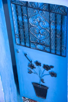 A blue door (one of many) beautifully adorned.