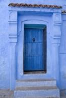 Blue door, blue frame, blue wall.