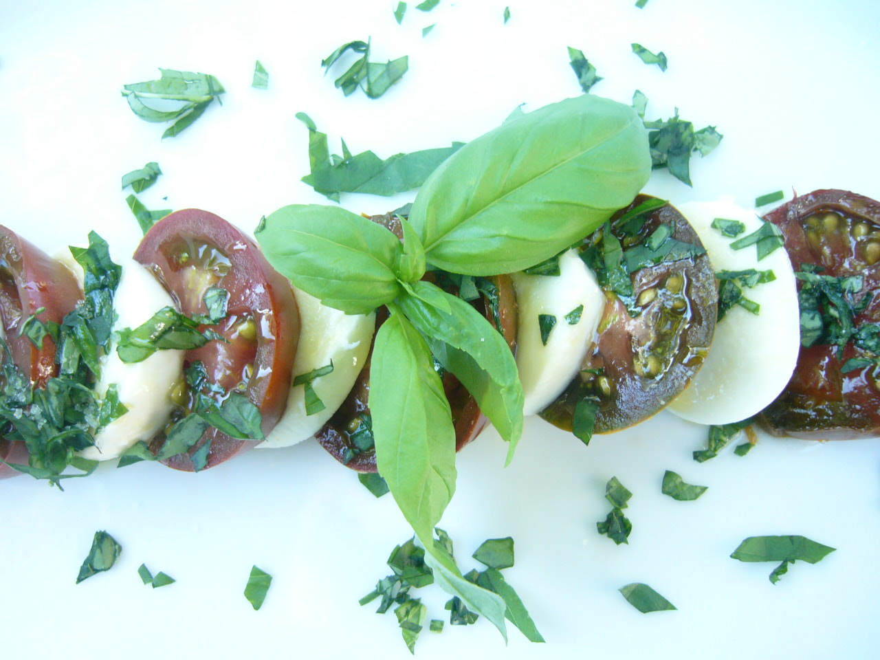 """""""Layered"""" Caprese Salad (made with heirloom tomatoes - they look green but are actually ripe)"""