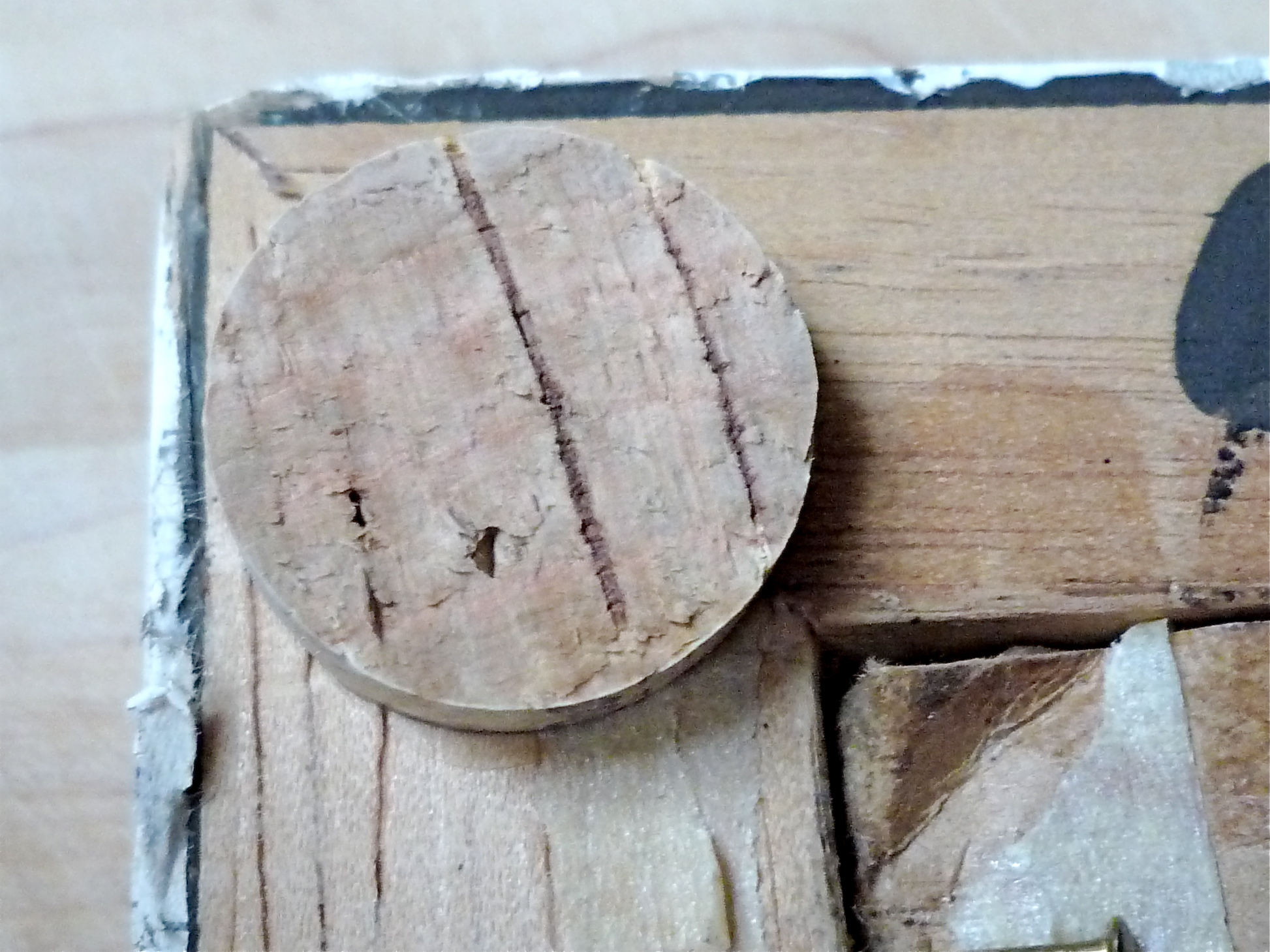 A few small pieces of cork will keep picture frames from marking your walls