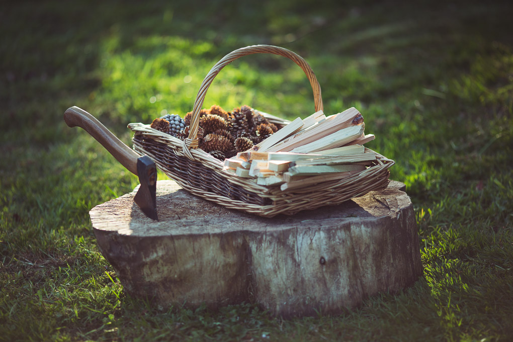 Fire and Wood Part 1: Pallet Wood Kindling -- Basket of pallet wood kindling and pine cones | https://theseasonaltable.co.uk/smallholding/fire-and-wood-part-1-pallet-wood-kindling/
